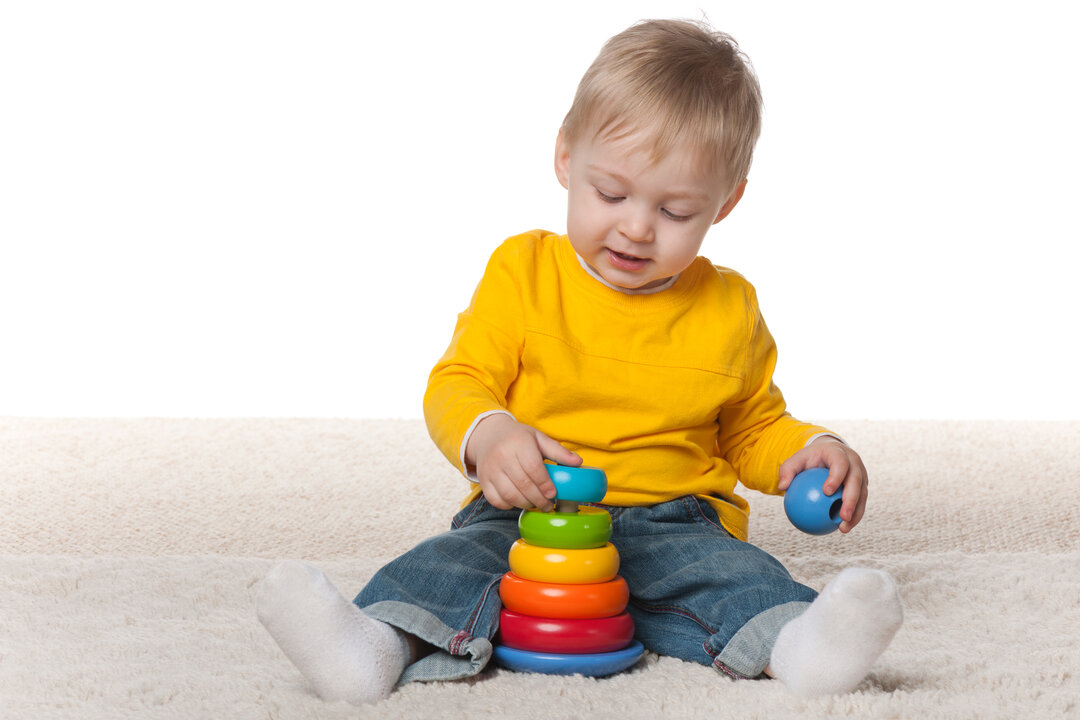 The pictures shows a child playing with toys