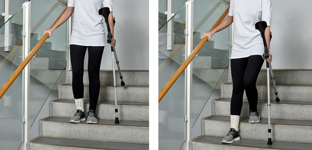Picture of a person walking down the stairs with crutches