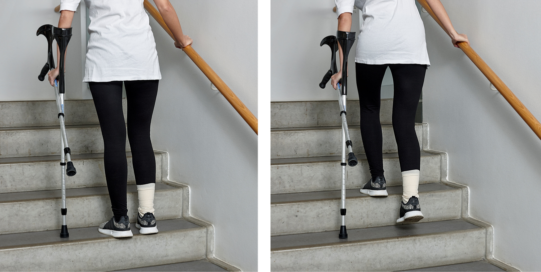 Picture of a person walking up the stairs with crutches