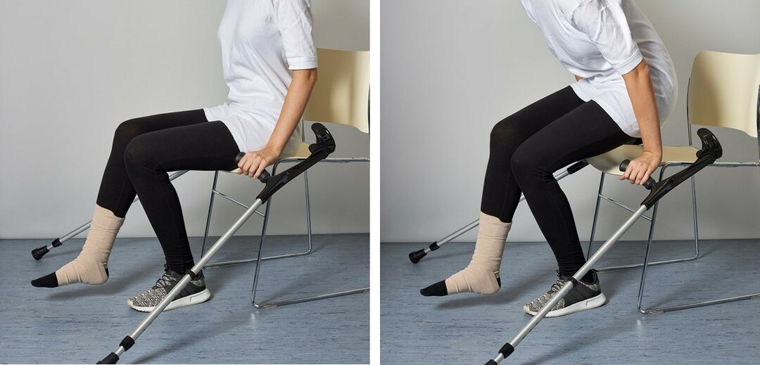 Picture of a person standing up from a chair