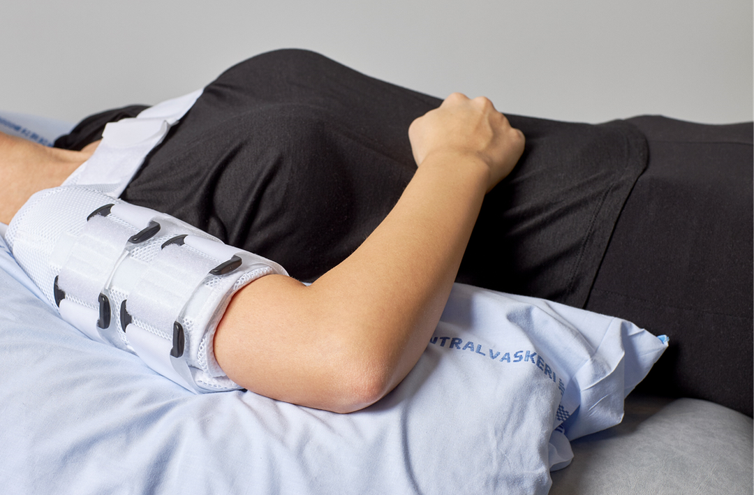 Picture of a person resting their arm on their stomach