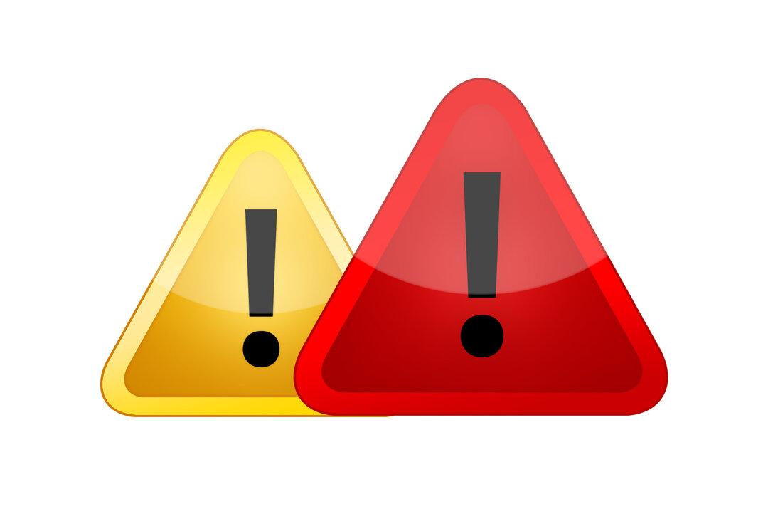 Illustration af en rød og gul trekant med udråbstegn i